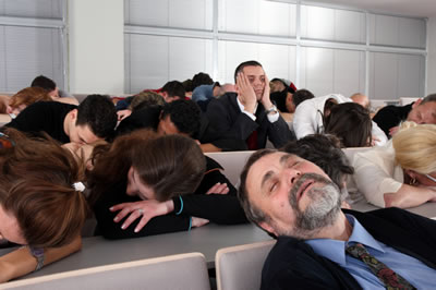 People asleep at a conference